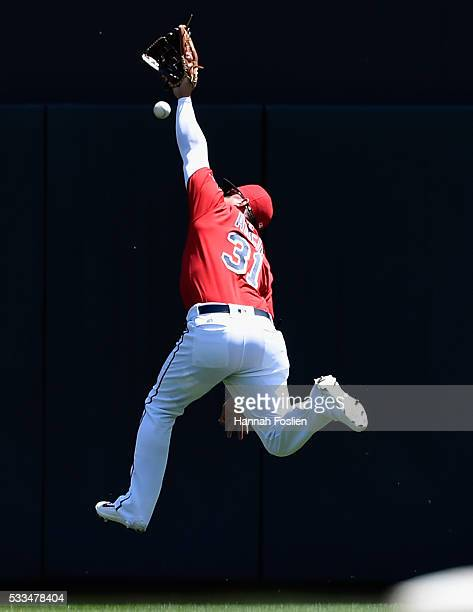Oswaldo Arcia of the Minnesota Twins misses a double hit by Kevin Pillar of the Toronto Blue Jays in right field during the second inning of the game...
