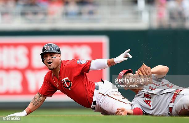 Oswaldo Arcia of the Minnesota Twins reacts after being tagged out by Andrelton Simmons of the Los Angeles Angels of Anaheim at second base during...
