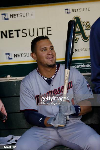 Oswaldo Arcia of the Minnesota Twins sits in the dugout prior to the game against the Oakland Athletics at Oco Coliseum on September 20 2013 in...