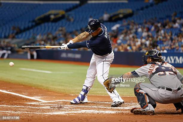 Oswaldo Arcia of the Tampa Bay Rays hits a single in front of catcher Jarrod Saltalamacchia of the Detroit Tigers during the second inning of a game...