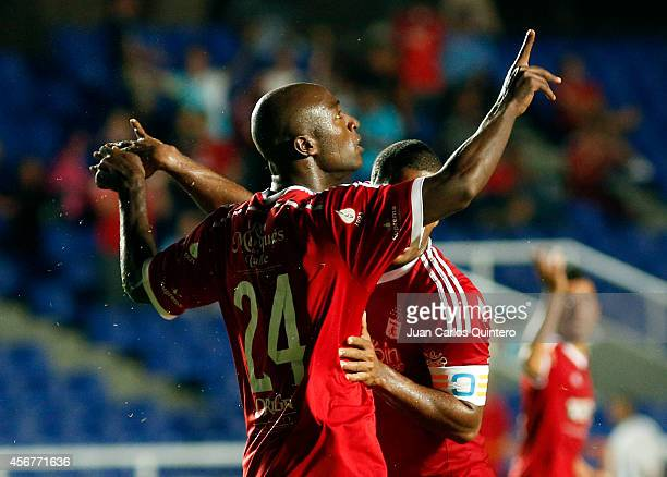 Oswaldo Blanco of America de Cali celebrates after scoring the first goal of his team during a match between America de Cali and Santander as part of...