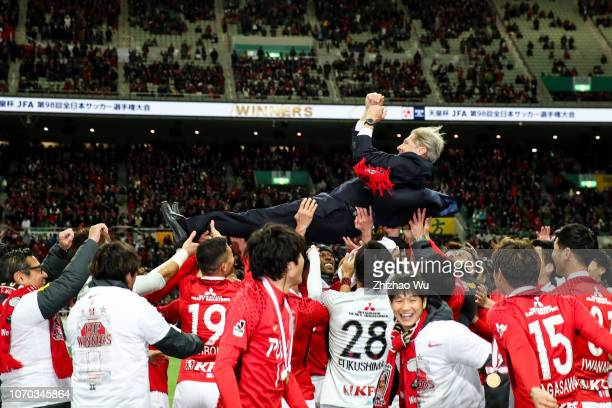 Oswaldo De Oliveira coach of Urawa Red Diamonds leads the players of Urawa Red Diamonds celebrate the champion after the 98th Emperor's Cup Final...