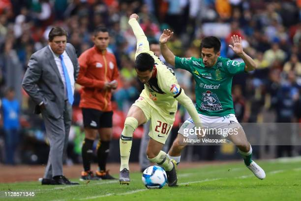 Oswaldo Leon of America struggles for the ball against Fernando Navarro of Leon during the 6th round match between America and Leon as part of the...