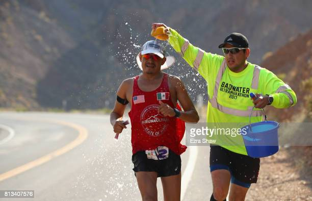 Oswaldo Lopez is sponged with water by a member of his support team Ulises Sanchez during the STYR Labs Badwater 135 on July 11 2017 in Death Valley...