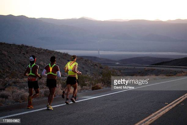 Oswaldo Lopez of Madera California and Carlos Alberto of Portugal run wearing headlamp near Panamint Springs as night falls during the AdventurCORPS...