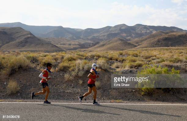 Oswaldo Lopez runs with a member of his support team Carlos Vasquez in the STYR Labs Badwater 135 on July 11 2017 in Death Valley California Lopez...