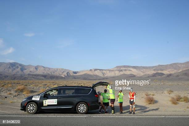 Oswaldo Lopez sits in his car surrounded by his support team after he had to pull out of the STYR Labs Badwater 135 on July 11 2017 in Death Valley...