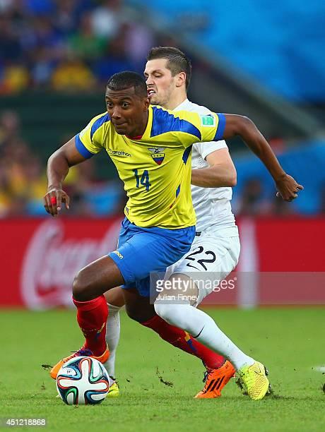 Oswaldo Minda of Ecuador controls the ball against Morgan Schneiderlin of France during the 2014 FIFA World Cup Brazil Group E match between Ecuador...