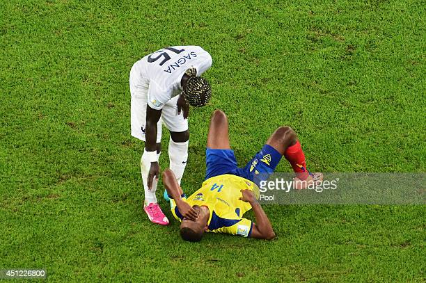 Oswaldo Minda of Ecuador is consoled by Bacary Sagna of France after a 00 draw during the 2014 FIFA World Cup Brazil Group E match between Ecuador...