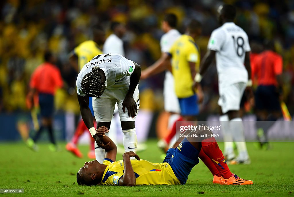 Oswaldo Minda of Ecuador is consoled by Bacary Sagna of France after the 2014 FIFA World Cup Brazil Group E match between Ecuador and France at Maracana on June 25, 2014 in Rio de Janeiro, Brazil.