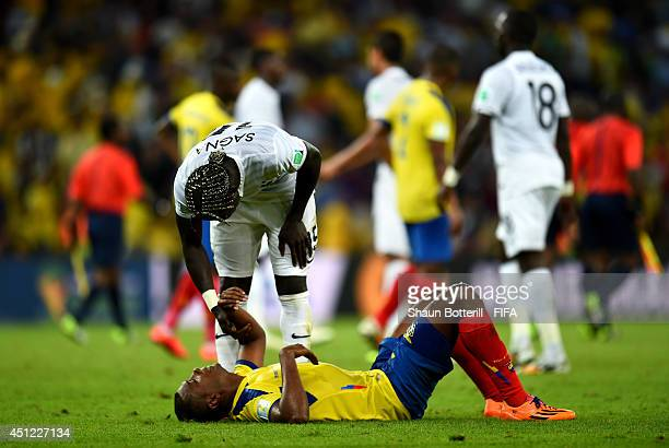 Oswaldo Minda of Ecuador is consoled by Bacary Sagna of France after the 2014 FIFA World Cup Brazil Group E match between Ecuador and France at...