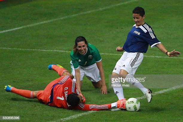 Oswaldo Sanchez Mexico's All Star Team struggles for the ball with Sissi of FIFA Football Legends during the FIFA Football Legends Match between...