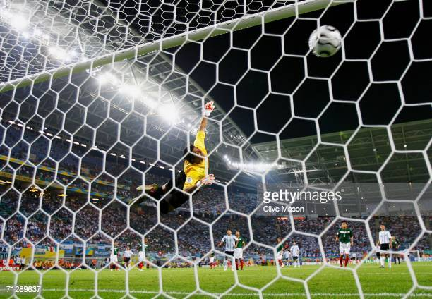 Oswaldo Sanchez of Mexico dives in vain as Maxi Rodriguez of Argentina scores in extra time during the FIFA World Cup Germany 2006 Round of 16 match...