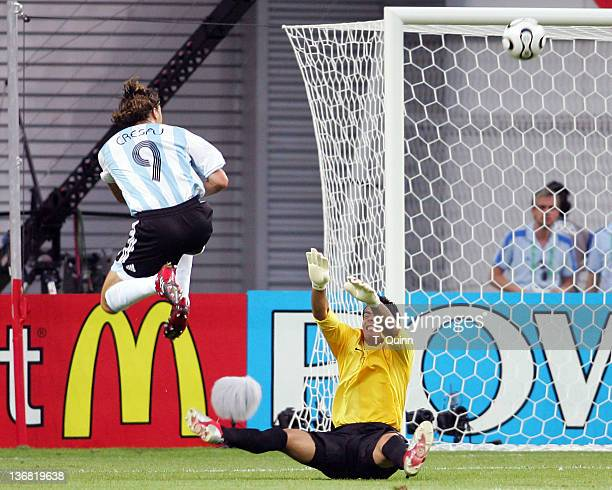 Oswaldo Sanchez of Mexico knocks a shot from Hernan Crespo of Argentina over the bar during the Round of 16 match at Zentralstadion in Leipzig...