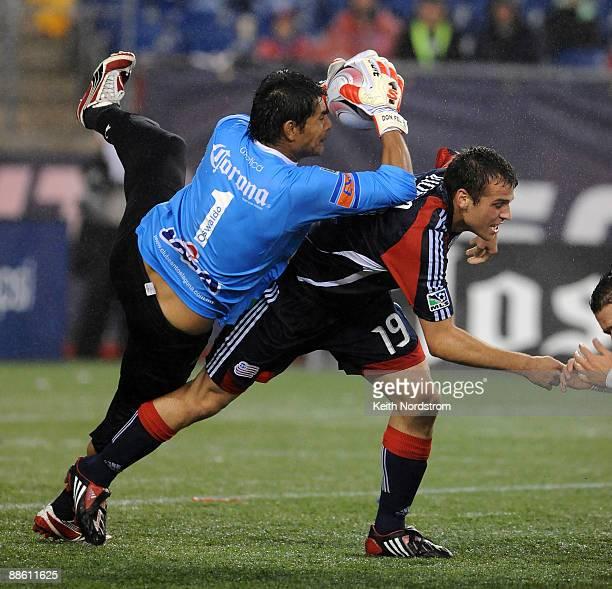 Oswaldo Sanchez of Santos Laguna makes a save over the back of Michael Videira of the New England Revolution during Super Liga Group B match June 21,...