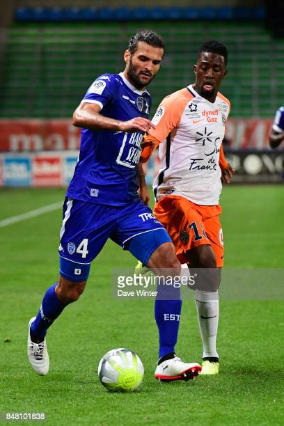 Oswaldo Vizcarrondo of Troyes and Isaac Mbenza of Montpellier during the Ligue 1 match between ESTAC Troyes and Montpellier Herault SC at Stade de...