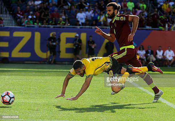 Oswaldo Vizcarrondo of Venezuela of fights for the ball with Jobi McAnuff of Jamaica during a group C match between Jamaica and Venezuela at Soldier...