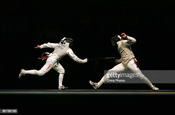 """Ota Yuki of Japan fights with Cheremisinov Alexey of Russia during their quarterfinal match in Men's Individual Foil at the """"Good Luck Beijing"""" 2008..."""