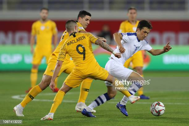 Otabek Shukurov of Uzbekistan battles for possession with Jamie Maclaren of Australia during the AFC Asian Cup round of 16 match between Australia...