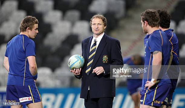 Otago coach Tony Brown talks to his inside backs prior to the round six ITM Cup match between Otago and Manawatu at Forsyth Barr Stadium on September...