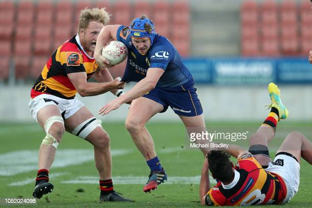 Otago's James Lentjes is just tackled by the Waikato defence during the round nine Mitre 10 Cup match between Waikato and Otago at FMG Stadium on...