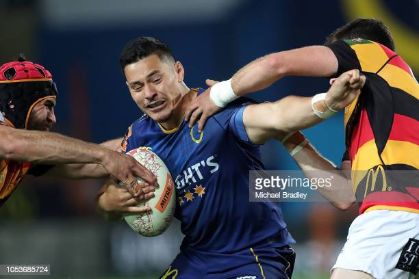 Otago's Patelesio Tomkinson looks to fend off the tackle during the Mitre 10 Cup Championship Final match between Waikato and Otago at FMG Stadium on...