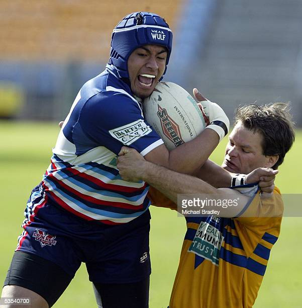 Otahuhu's Slalii Tufeao fends off Mt Albert's Steve Buckingham during the Bartercard Cup preliminary final rugby league match at Ericsson Stadium...