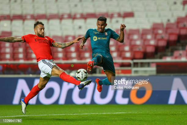 Otamendi of SL Benfica vies with Wenderson Galeno of SC Braga for the ball possession during the Liga NOS round seven match between SL Benfica and SC...