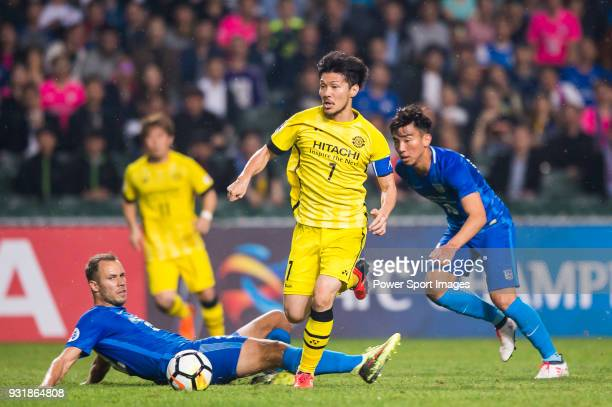 Otani Hidekazu of Kashiwa Reysol fights for the ball with Kitchee SC's players during the AFC Champions League Group E match between Kitchee and...