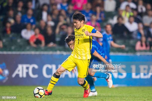 Otani Hidekazu of Kashiwa Reysol fights for the ball with Li Ngai Hoi of Kitchee SC during the AFC Champions League Group E match between Kitchee and...