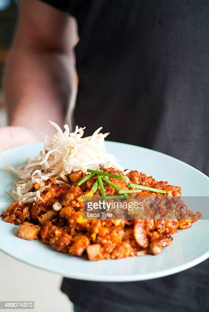 Otaow pan fried oysters with soyasauce taro dried shrimp and crispy pork an example of Baba food brought to Phuket by Hokkien Chinese migrants who...