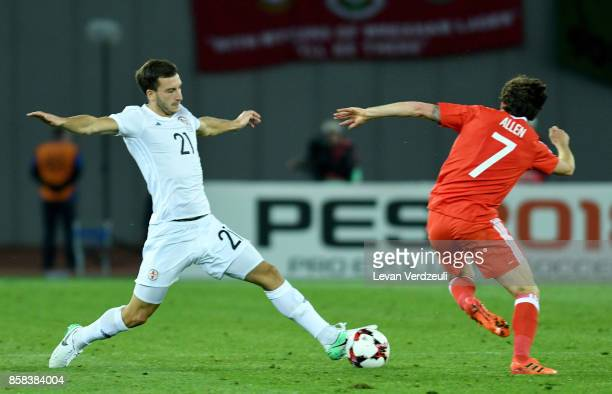 Otar Kakabadze of Georgia and Joe Allen of Wales in action during the FIFA 2018 World Cup Qualifier between Georgia and Wales at Boris Paichadze...