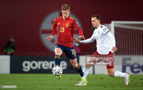 Otar Kakabadze of Georgia competes for the ball with Daniel Olmo of Spain during the FIFA World Cup 2022 Qatar qualifying match between Georgia and...