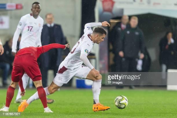 Otar Kiteishvili of Georgia and Granit Xhaka of Switzerland battle for the ball during the UEFA Euro 2020 Qualifier between Switzerland and Georgia...