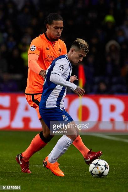 Otavio Edmilson da Silva of FC Porto is challenged by Virgil Van Dijk of Liverpool FC during the UEFA Champions League Round of 16 First Leg match...