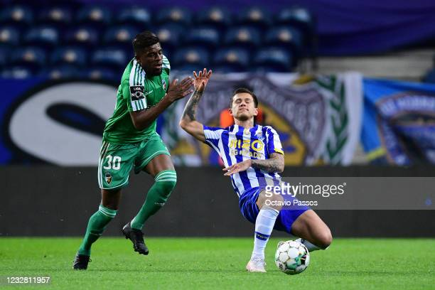 Otavio of FC Porto and Baner Felipe of SC Farense in action during the Liga NOS match between FC Porto and SC Farense at Estadio do Dragao on May 10,...