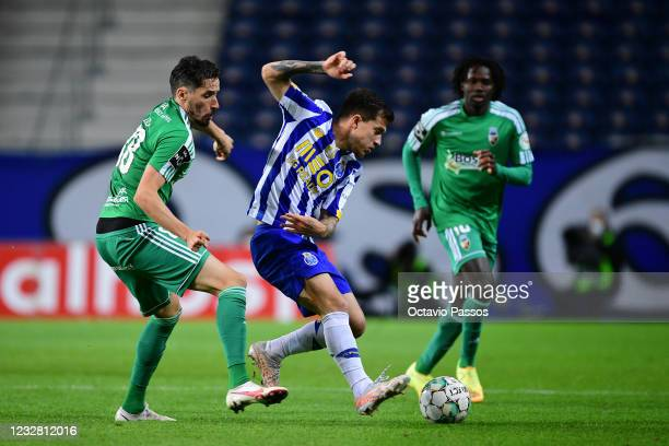 Otavio of FC Porto and Lica of SC Farense in action during the Liga NOS match between FC Porto and SC Farense at Estadio do Dragao on May 10, 2021 in...