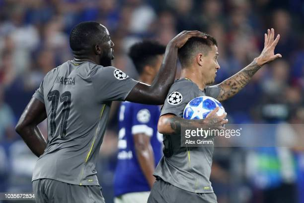 Otavio of FC Porto celebrates with Moussa Marega of FC Porto after he scores his sides first goal from the penalty spot during the Group D match of...