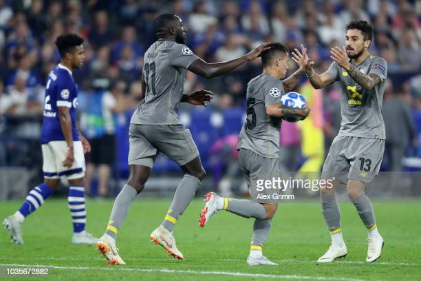 Otavio of FC Porto celebrates with Moussa Marega of FC Porto and Alex Telles of FC Porto after he scores his sides first goal from the penalty spot...