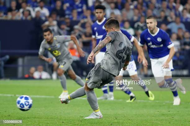 Otavio of FC Porto scores his sides first goal from the penalty spot during the Group D match of the UEFA Champions League between FC Schalke 04 and...
