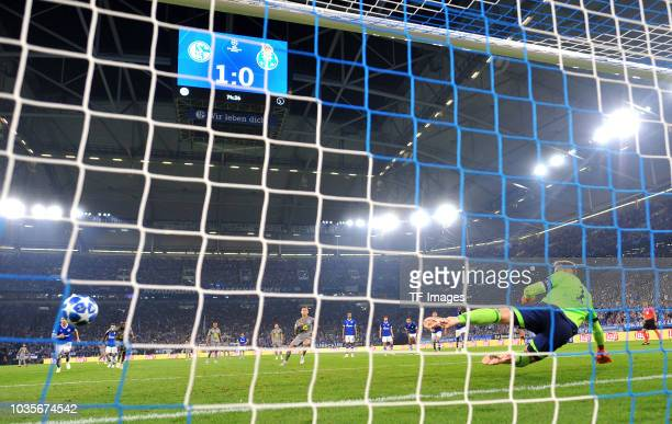 Otavio of FC Porto scores the team`s first goal and goalkeeper Ralf Faehrmann of FC Schalke in action during the UEFA Champions League Group D match...