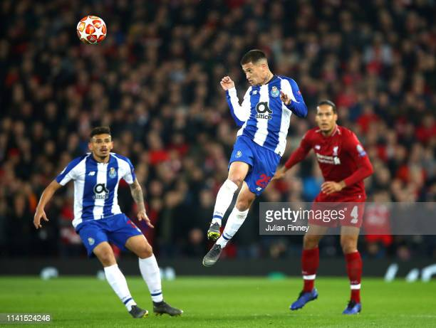 Otavio of FC Porto wins a header during the UEFA Champions League Quarter Final first leg match between Liverpool and Porto at Anfield on April 09...