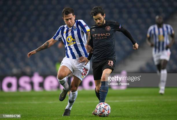 Otavio of Porto battles for possession with Bernardo Silva of Manchester City during the UEFA Champions League Group C stage match between FC Porto...
