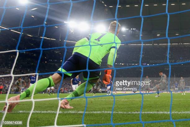Otavio of Porto scores his team's first goal from the penalty spot against goalkeeper Ralf Faehrmann of Schalke during the UEFA Champions League...