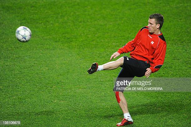 Otelul Galati's defender Silviu Ilie attends a training session at Luz Stadium in Lisbon, on December 6 on the eve of their Champions League football...