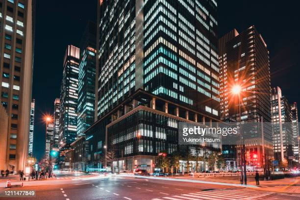 otemachi, tokyo nightscape - road junction stock pictures, royalty-free photos & images