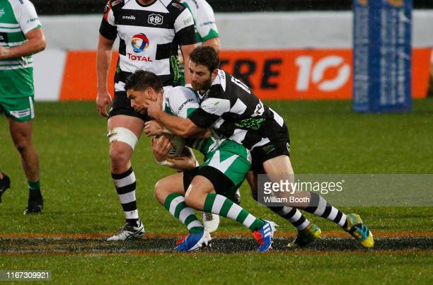 Otere Black of Manawatu is tackled by Mason Emerson during the round 1 Mitre 10 Cup match between Manawatu and Hawke's Bay at Central Energy Trust...