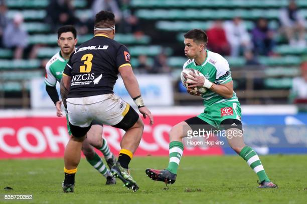Otere Black of Manawatu looks to beat the challenge of Alex Fidow of Wellington during the round one Mitre 10 Cup match between Manawatu and...