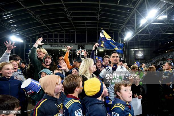 Otere Black of the Blues is interviewed as fans swarm the field during the round eight Super Rugby Aotearoa match between the Highlanders and the...