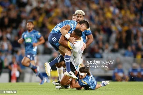 Otere Black of the Blues makes a tackle on Julian Savea of the Hurricanes during the round 6 Super Rugby Aotearoa match between the Blues and the...